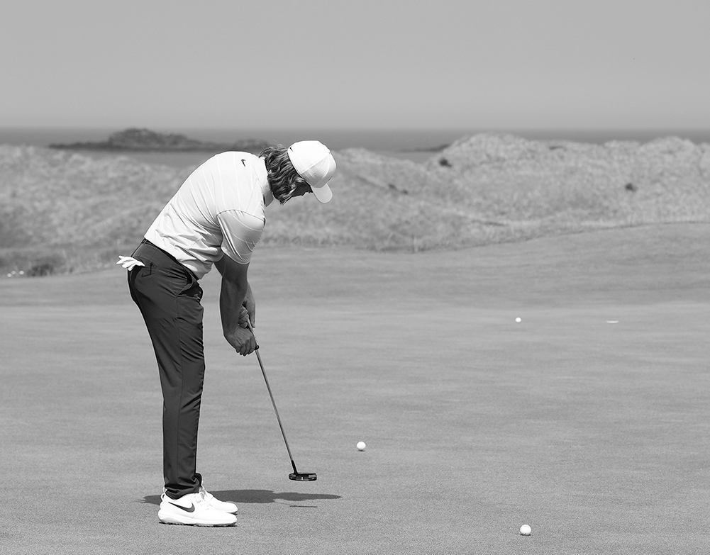 When putting, how do you promote a stable face at impact position?