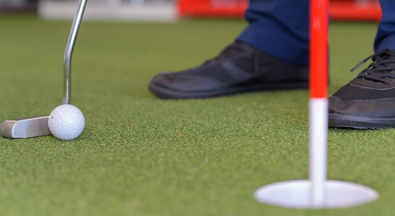 What's a good indoor drill for a beginning golfer to work on their putting stroke?